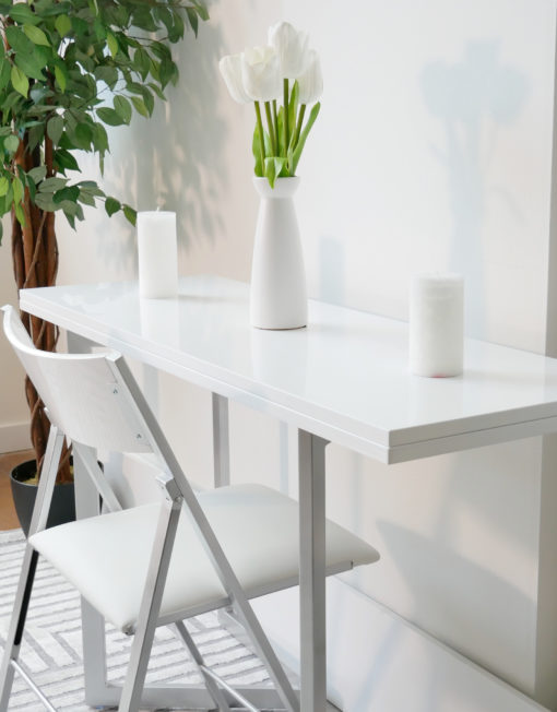 Flip-console-closed-in-glossy-white-being-used-as-a-small-desk-with-transforming-options