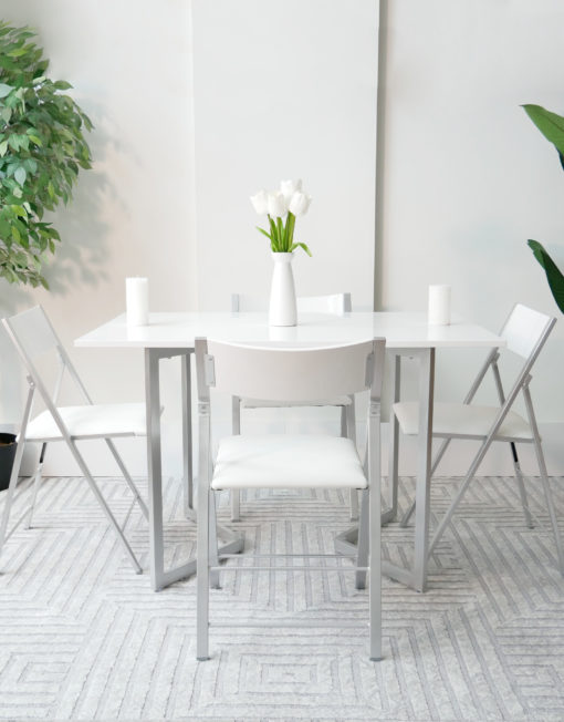 Flip-console-to-table-in-glossy-white-opened-in-dining-form-with-4-nano-chairs-in-a-modern-room-with-grey-carpet-from-side