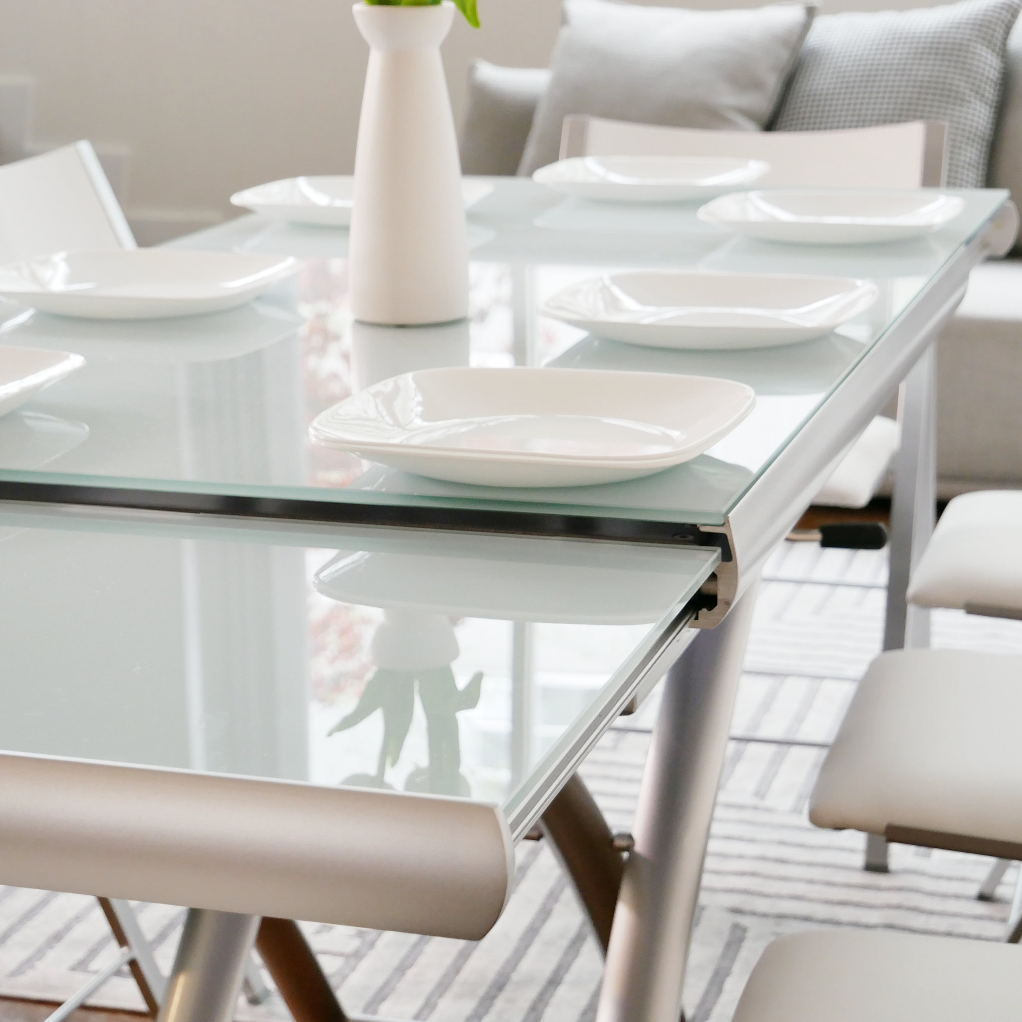 Picture of: Transforming Extending Glass Table Expand Furniture