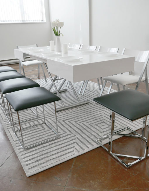 White-Box-coffee-with-black-companion-cube-seating-around-it-and-white-nano-chairs