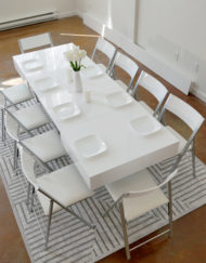 White-Gloss-Box-Coffee-table-with-10-nano-white-chairs-around-it-bright