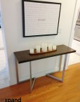 compact console-to-dining-table-in-walnut