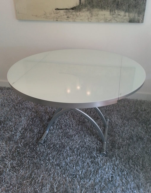 smart-glass-lifting-round-dining-table-in-its-large-size