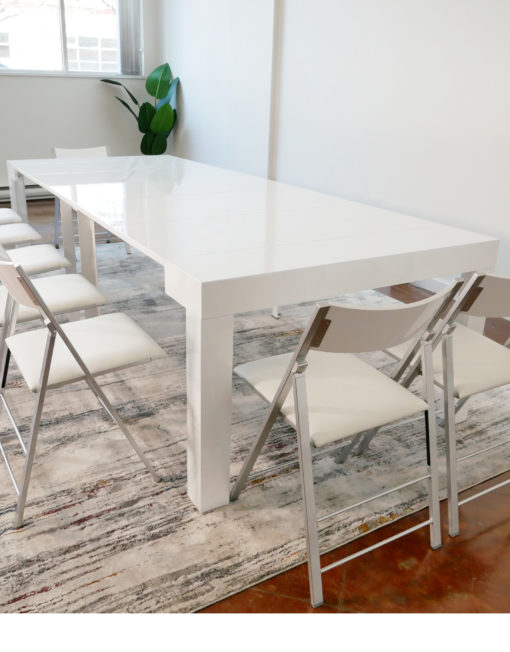 White-Tiny-Titan-Transformer-Table-extends-to-seat-14-with-2-chairs-on-the-ends