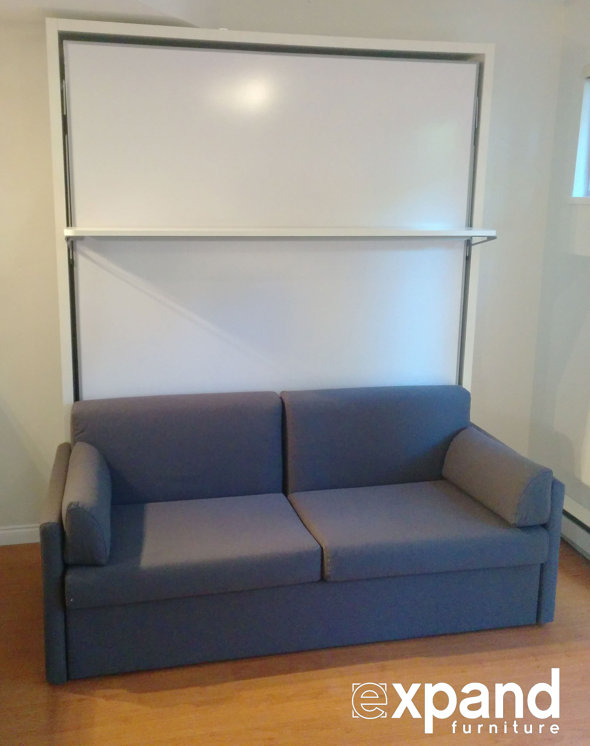 compatto murphy bed over sofa with floating shelf