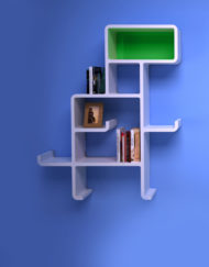 Wall-Shelf-Dinosaur-in-white-with-green-face-on-blue-wall