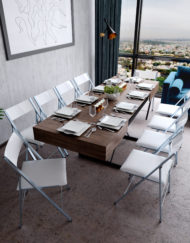 Transforming Box Coffee dinner table in extended form. Chocolate walnut panel finish with table ware decorating table and white nano chairs surround the table
