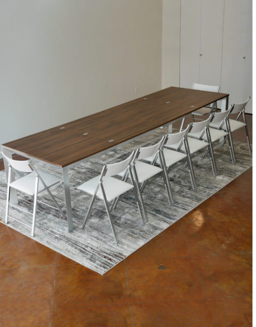 mega-abode-super-extended-14-person-table-in-chocolate-walnut-with-silver-legs-and-nano-chairs-around-it