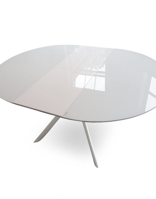 Tide-round-extended-white-glass-table-with-metal-legs