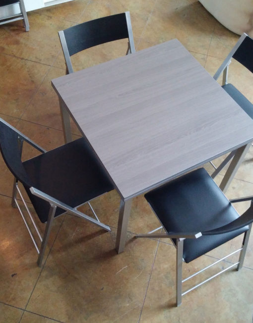 converting-Echo-Square-table-with-4-black-folding-chairs