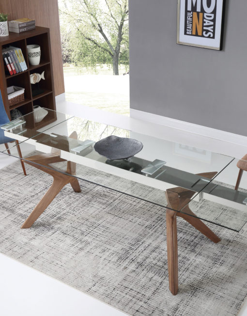 A Transparent Glass Rectangular Table With Extensions On