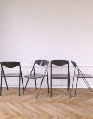 Magro-Thin-Grey-Folding-Chairs-in-white-room-with-trendy-wood-floor-Expand-Furniture