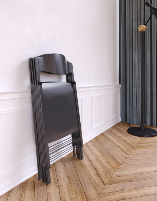 Magro-thin-folding-chairs-in-grey-designer-folded-flat-against-a-wall