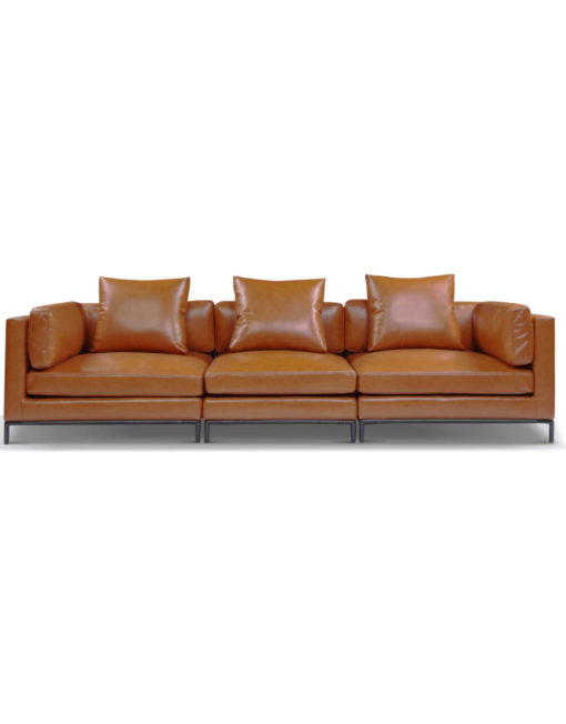 3 seat wide large leather sofa in brown orange in a mid century modern design